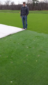 Kyle Genova pulled back permeable turf cover to inspect annual bluegrass growth and progress of the Microdochium Patch inoculation on 28 December 2015. Turf is still growing and disease is expanding.